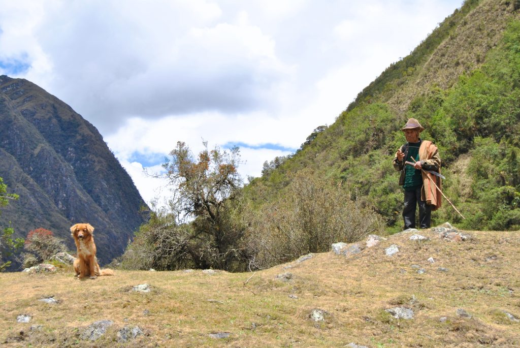Peruvian locals and his dog on the Santa Cruz Trek in Peru