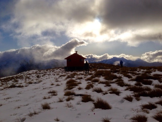 Clouds against Brewster Hut in the shadows