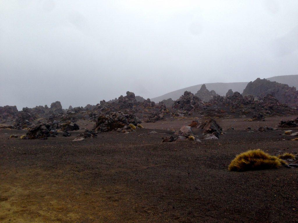 Tongariro landscape of dark sand and rocks